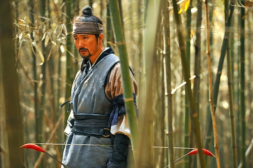 Nam-i momentarily gives his bow a rest in a bamboo forest