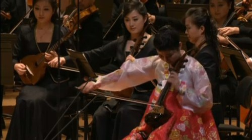 Ha Nam-un playing a four-stringed haegum. Note a similar haegum and a mandolin (oungum) in the orchestra behind