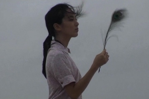 So-yeon with her peacock feather