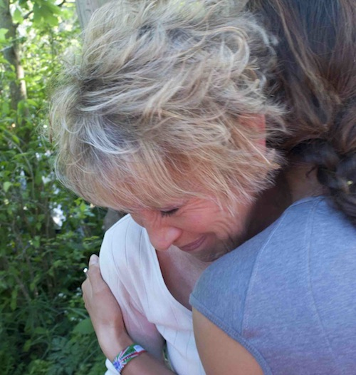 Carol Klein crying with Hwang Jihae in her Gold medal DMZ garden at Chelsea Flower show