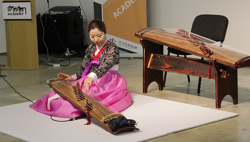 Jung-Ji-eun demonstrates the kayageum in the class on traditional Korean music