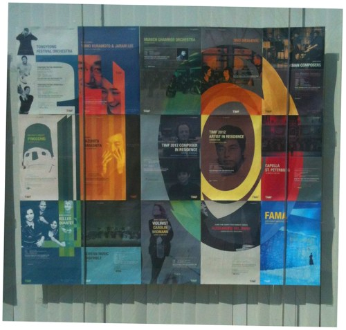 A poster for the 10th Tongyeong International Music Festival, displayed in the window of the Yun Isang Memorial Hall