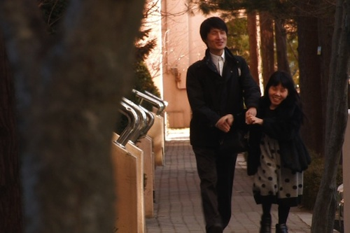 Young-chan and Soon-ho chat as they wander down the street