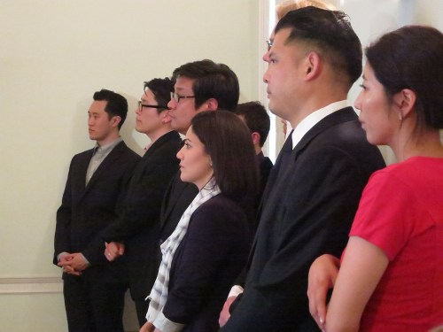 The BBC's Mishal Husain, Curator Stephanie Seungmin Kim and the singers watch the speeches