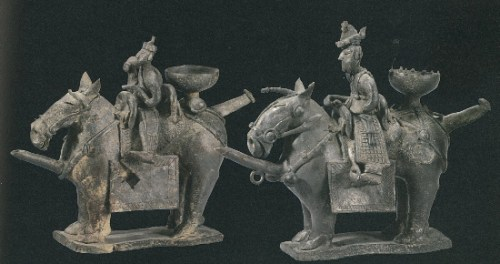 A pair of earthenware figures that were used as vessels for carrying liquids or as lamp holders, excavated from the Gold Bell Tomb in 1924. National Treasure No 91
