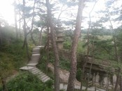 The stairway that assists you on your climb to visit the Stone Statues of the Lying Buddha
