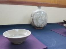 A smaller buncheong vase alongside one of his tea bowls
