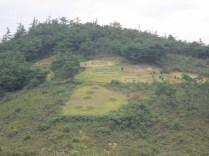 Some of the many burial mounds in the hills surrounding Unjusa