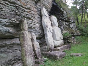 Some of the stone statues left lying against the rocks