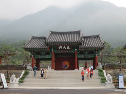 The Gate of Heavenly Gi, with the peak of Wangsan lost in the mist behind