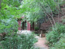 The Chinese-style pavilion in the Seokpageong's natural wooded gardens