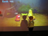 A young visitor is entertained by some of the animation