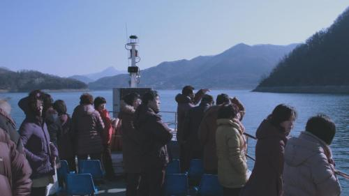 Tourists cruise above the submerged villages