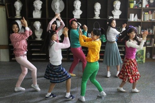 Sunny: The girls practice their dance routine at school