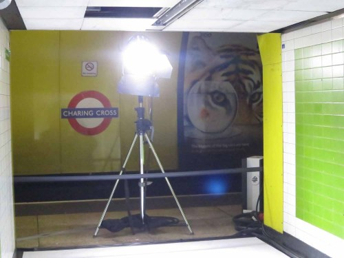 A spotlight and a barrier blocks the entrance to the platforms