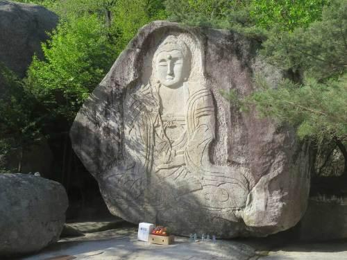 The seated rock-carved buddha at Baekundae, Bongamsa