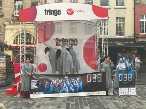 Taiwanese performers advertise their show on the Royal Mile