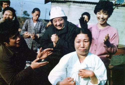 The widow entertains the people of the slum