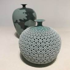 Kim Seyong: Celadon Chrysanthemum double-walled vase with (behind) Celadon bottle with peony decoration