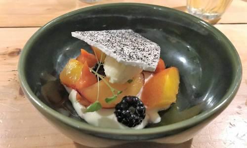 Nectarine with a black garlic wafer