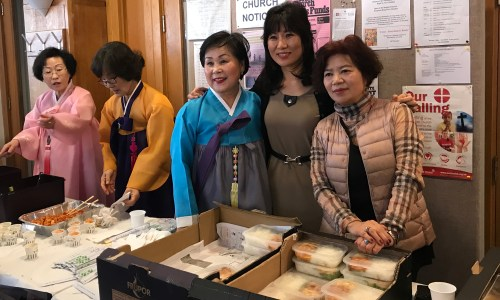 Some of the volunteers serving lunch and five different types of kimchi