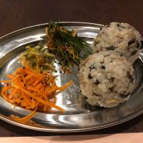 Icheon rice balls with mushroom bulgogi topped with pickled carrot