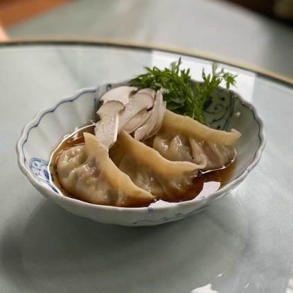 Vegetable and tofu mandu, mushroom broth, gamtae seaweed