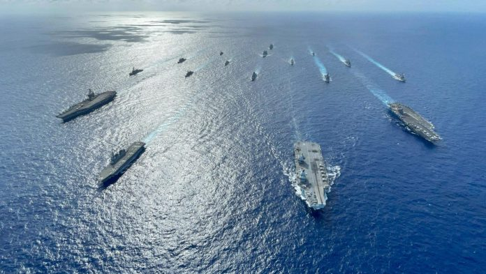 https://i2.wp.com/londonlovesbusiness.com/wp-content/uploads/2021/10/HNLMS-Evertsen-carrier-strike-group-Philippine-Sea-1536x867.jpg?resize=696%2C393&ssl=1