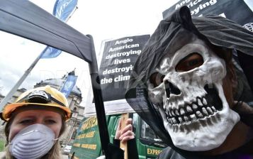 1366423291-protesting-for-human-rights-environmental-abuses-of-mining-in-london_1973885