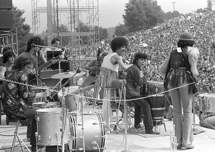 Mexican-American musician Carlos Satana and his band perform at the Woodstock Festival, Bethel, NY, August 1969. © Iconic Images/Baron Wolman