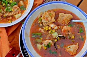 Seafood and Roasted Corn Stew. Freshly roasted corn gives this light-tasting seafood stew with tomatoes, oregano, cilantro and white wine the extra body you want in a summer main course dish. Credit: Copyright 2016 Rinku Bhattacharya