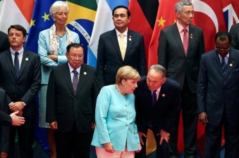 Germany's Chancellor Angela Merkel talks to Kazakhstan's President Nursultan Nazarbayev as leaders pose for a group picture during the G20 Summit in Hangzhou, Zhejiang province, China September 4, 2016. REUTERS/Damir Sagolj