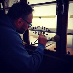 Double coating lettering on glass Nick Garrett London