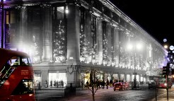 Selfridges Department Store on Oxford Street is lit up by Christmas decorations on December 6, 1935