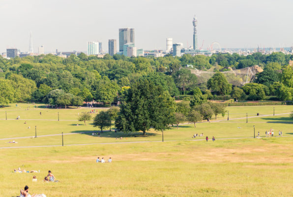LONDON - MAY 10, 2015. Tourists relax in Primrose Hill Park. Lon