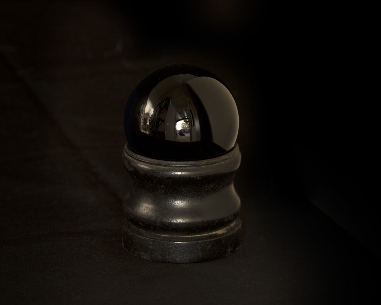 Small black crystal ball, used by Paignton witch 'Smelly Nelly' (c) Museum of Witchcraft, Boscastle