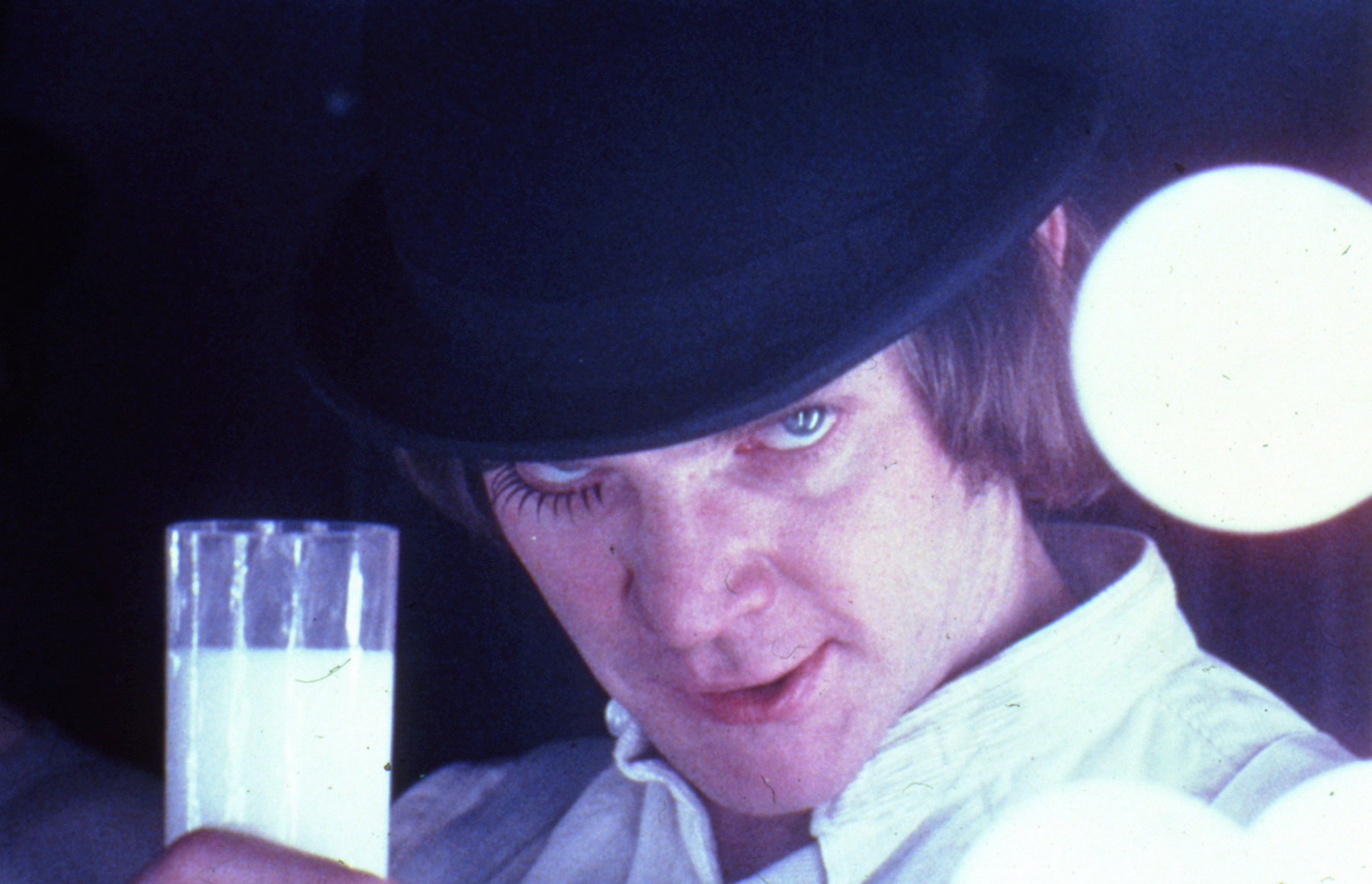 A Clockwork Orange, directed by Stanley Kubrick (1970-71; GB/United States). Alex DeLarge (Malcolm McDowell) in the Korova Milkbar. © Warner Bros. Entertainment Inc