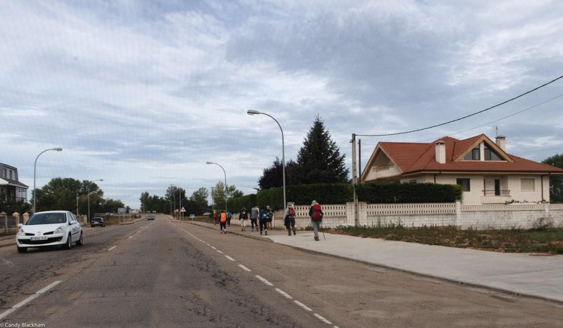 Pilgrims setting off from Hospital de Orbigo on the Camino