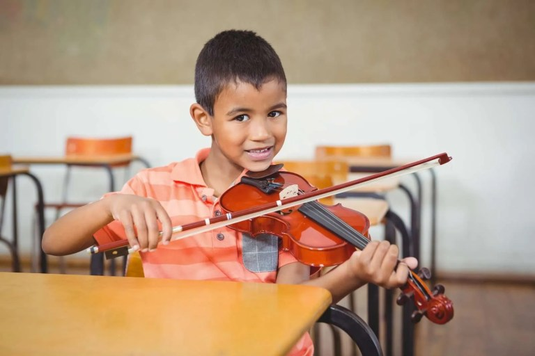 19592796_student-using-a-violin-in-class
