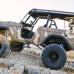 Lifted Camo Lonestar 4x4 Jeep Drivers Side View