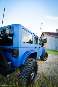Sprayed Blue Jeep Rubicon Rear Passenger Side View