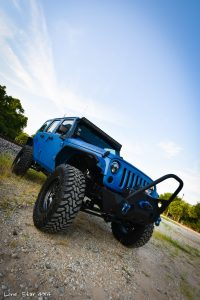 Sprayed Blue Jeep Rubicon Passenger Side Front View
