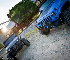 Grey Jeep and Sprayed Blue Jeep Rubicon