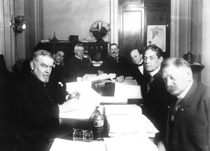 This is a picture of the Senate Banking Committee in session during the debate about the Federal Reserve Act of 1913. At the time, Robert L. Owen, pictured on the right, was head of the committee. Image courtesy of the Federal Reserve Bank of Kansas City.