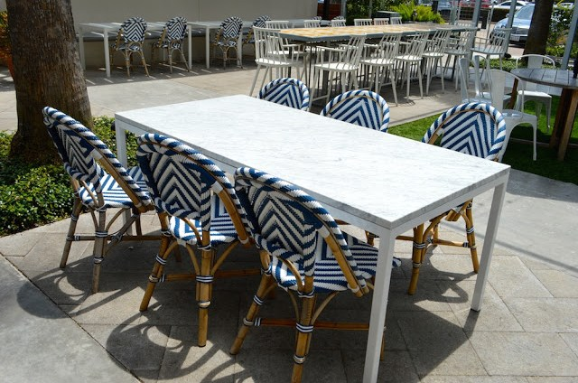 white marble table and blue french chairs, local river oaks houston