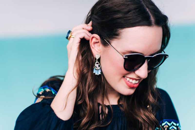 Blogger Alice Kerley from Lone Star Looking Glass pairs BaubleBar's Verbena Drop Statement earrings with a Blue Druzy Cocktail Ring.