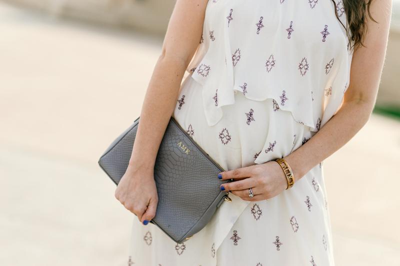 Texas fashion blogger Alice Kerley styles a gray Gigi New York monogrammed clutch.