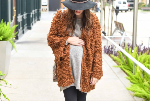 Texas blogger Alice Kerley shares boho maternity outfit inspiration with an oversized mustard sweater, rancher hat and Swedish Hasbeen booties.