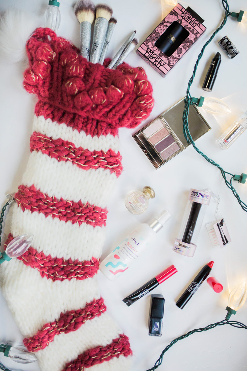 Holiday Beauty Stocking Stuffer Ideas in a red and white Anthropologie Stocking.