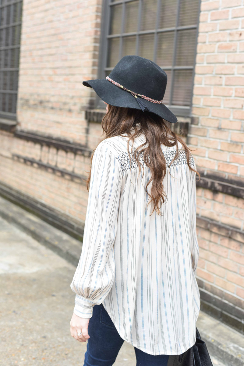 Texas fashion blogger dresses up Anthropologie's Northfork Striped Buttondown Tunic with black accessories.